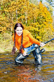 Woman fishing in Otava river, Czech Republic — Stock Photo