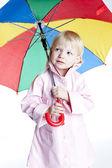Little girl with umbrella — Stock Photo