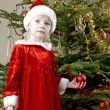 Santa Claus by Christmas tree — Stock Photo #7587549