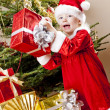 Little girl as Santa Claus with Christmas presents — ストック写真
