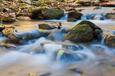 Blue water of mountain stream — Stock Photo