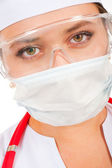Face of a young doctor in a protective mask — Stock Photo