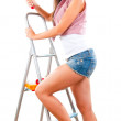 Beautiful young girl is going to do repair — Stock Photo