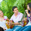 Young friends play the guitar and trumpet — Stock Photo #6863732