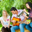 Young friends play the guitar and trumpet — Stock Photo #6863743