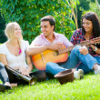 Young friends play the guitar and trumpet — Stock Photo #6863749
