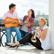 Young friends play the guitar and trumpet — Stock Photo #6863755