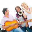 Young friends play the guitar and trumpet — Stock Photo #6863760