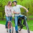 Happy young couple riding bicycles — Stock Photo #6928137