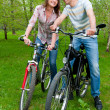 Happy young couple riding bicycles — Stock Photo #6928146