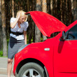 Blonde and broken car — Stock Photo #6928149