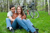 Young couple resting in a park — Stock Photo