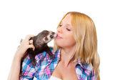 Girl kissing a ferret — Stock Photo