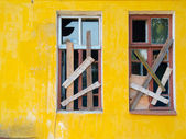Two windows boarded — Stockfoto