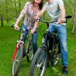Happy young couple riding bicycles — Stock Photo #7058379