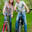 Stock Photo: Happy young couple riding bicycles