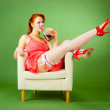 Pin-up style girl sitting on the chair — Stock Photo