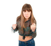 Angry teen girl threatened with fists — Stock Photo