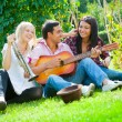 Young friends play the guitar and trumpet — Stock Photo #7131710