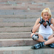 Young woman wears roller skates — Stock Photo