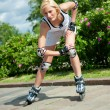 Girl roller-skating in the park — Lizenzfreies Foto