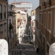 Street in the old centre in Lisbon, Portugal - Stock Photo