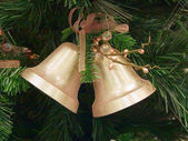 Two bells on the christmas fir — Stock Photo