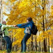 Stock Photo: Happy young couple with backpacks in park