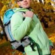 Happy young man with backpack in the park. — Stock Photo