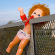 Thrown out doll - Stock Photo