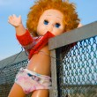 Stock Photo: Thrown out doll