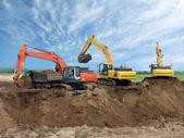 Three Excavators — Stock Photo