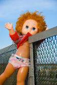 Thrown out doll — Stock Photo