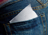 Paper in the jeans pocket — Stock Photo