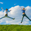 Happy teenagers jumping — Stock Photo