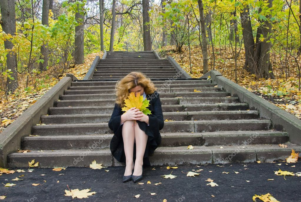 Middle age woman in depression on an autumn nature — Stock Photo #7610926