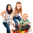 Mother carries her children in a shopping cart — Stock Photo #7642541