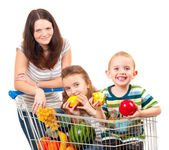 Mother carries her children in a shopping cart — Stock Photo