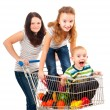 Mother carries her children in a shopping cart — Stock Photo #7679573