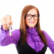Realtor handing the keys isolated over white — Stock Photo #7704543