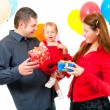 Royalty-Free Stock Photo: Parents celebrate their daughter\'s birthday