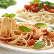 Fork with pasta and basil — Stockfoto