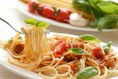 Fork with pasta and basil — Stock Photo
