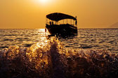 Sunset and boat — Stock Photo