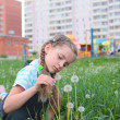 Child with flowers — Stock Photo #6813177