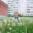 Child in the flowers — Stock Photo #6813227