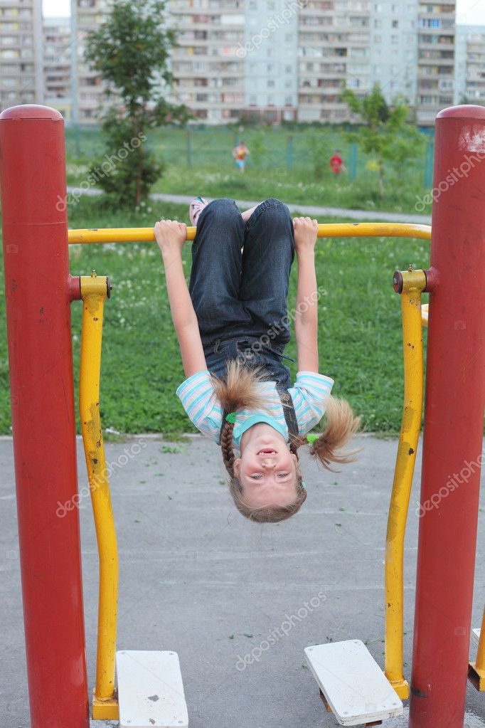 Cute little girl playing on the playground outdoor — Stock Photo #6822847