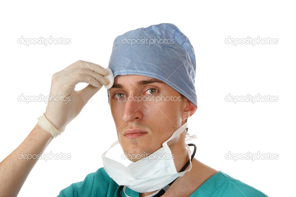 Tired male doctor after performing an operation on a patient — Stock Photo #6822879