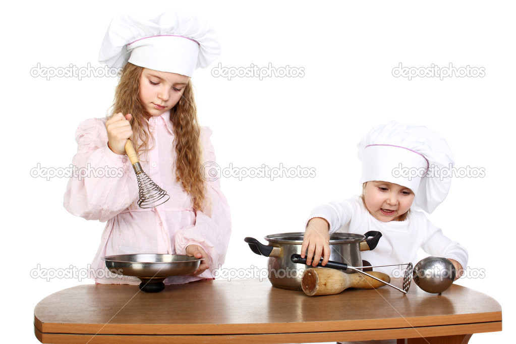 Two cute little girls dressed as cooks — Stock Photo #6823197