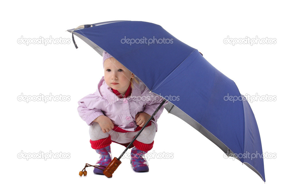 Cute little child sittung under the big umbrella — Stock Photo #6823206